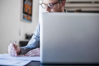 Man at computer working on marketing project