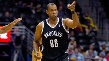 Jason Collins points after scoring basket