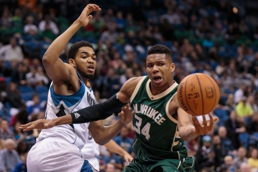 Oct 23, 2015; Minneapolis, MN, USA; Milwaukee Bucks forward Giannis Antetokounmpo (34) loses control of the ball in front of Minnesota Timberwolves center Karl-Anthony Towns (32) in the second quarter at Target Center. Mandatory Credit: Brad Rempel-USA TODAY Sports