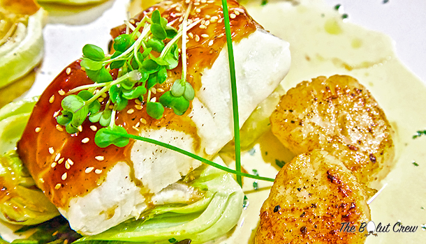 Honey soy glazed Chilean sea bass with sea scallops and roasted baby bok choy
