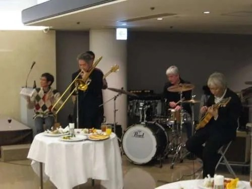 Mr Mashima playing trombone at a reception after a concert which he conducted on 11 Jan 2010