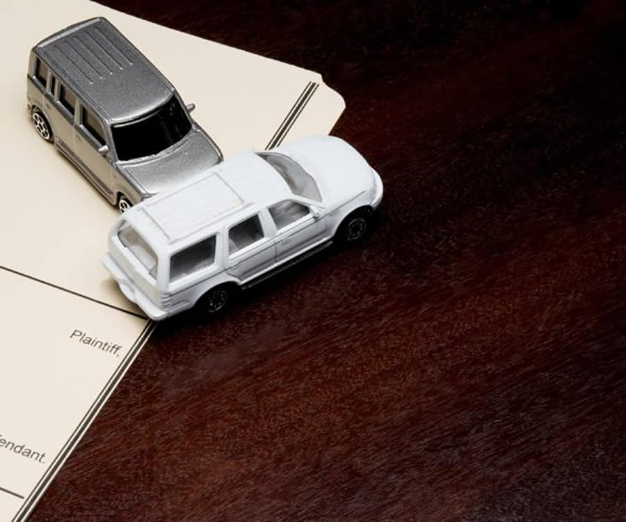 two car figurines colliding