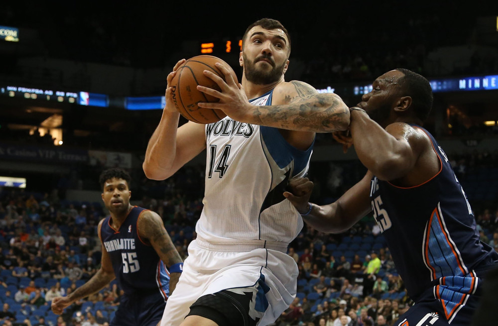 Jan. 10, 2014 - Minneapolis, MN, USA - The Minnesota Timberwolves' Nikola Pekovic, middle, tries to make a move to the basket against the Charlotte Bobcats' Al Jefferson during the first half at Target Center in Minneapolis. (Kyndell Harkness/Zuma Press/Icon Sportswire)