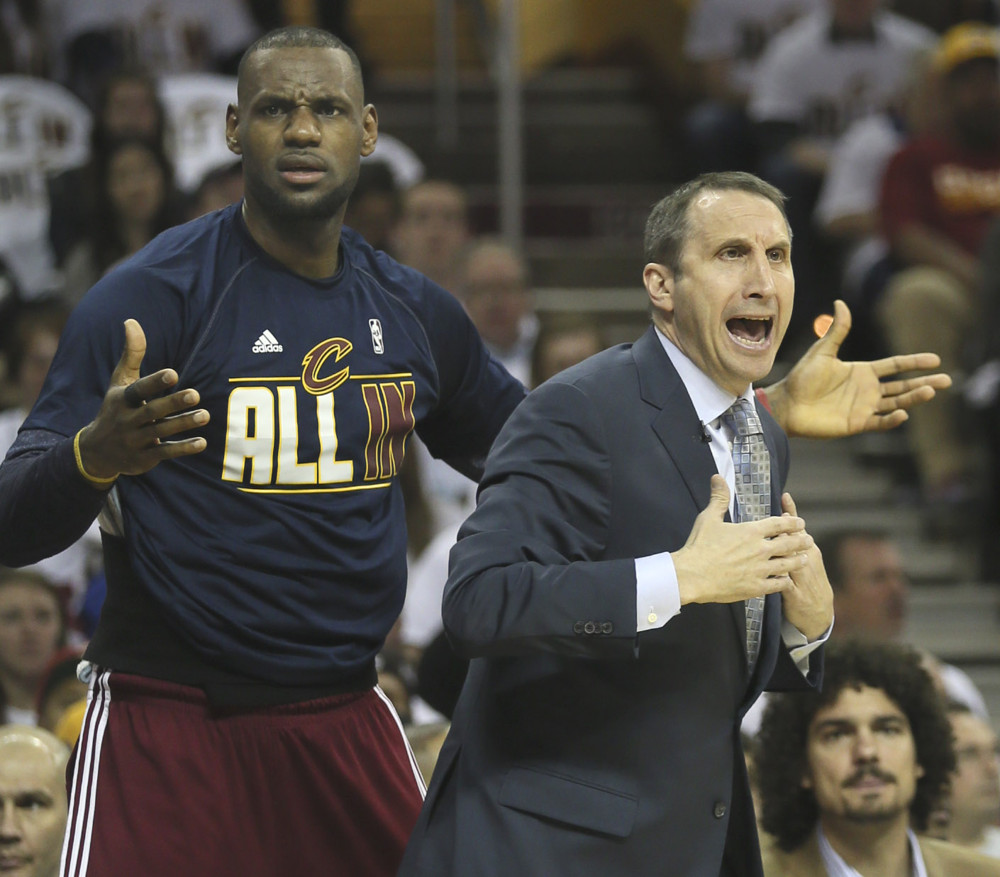 April 19, 2015 - Cleveland, OH, USA - Cleveland Cavaliers' LeBron James and head coach David Blatt question an official's call during the first quarter on Sunday, April 19, 2015, at Quicken Loans Arena in Cleveland, Ohio. (Phil Masturzo/Zuma Press/Icon Sportswire)