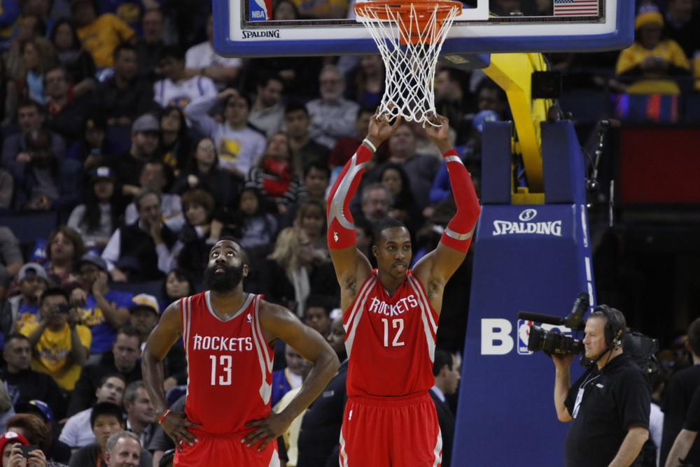 Dec. 13, 2013 - Dec 13, 2013 - Oakland, CA, USA: James Harden (13) and Dwight Howard (12) of the Houston Rockets celebrate the victory after a game against the Golden State Warriors at Oracle Arena. (Osports/Zumapress/Icon Sportswire)