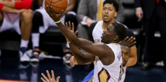February 25, 2016: New Orleans Pelicans guard Jrue Holiday (11) drives to the basket during the NBA game between the Oklahoma City Thunder and the New Orleans Pelicans at the Smoothie King Center in New Orleans, LA. (Photograph by Stephen Lew/Icon Sportswire)