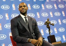 May 5, 2013 - Miami, FL, USA - Miami Heat forward LeBron James sits by the Maurice Podoloff Trophy during a ceremony at the American Airlines Arena in Miami, Florida, Sunday, May 5, 2013. James was selected as the NBA's Most Valuable Player (Zumapress/Icon Sportswire)