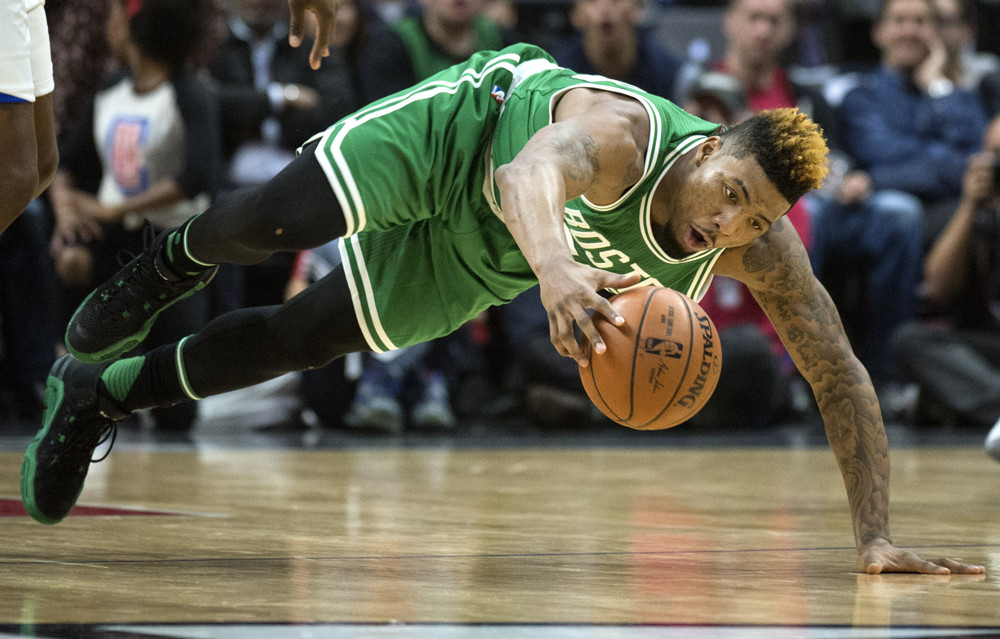 March 28, 2016 - Los Angeles, CA, USA - Boston Celtics guard Marcus Smart (36) dives to recover a loose ball during a game against the Los Angeles Clippers at Staples Center on Monday, March 28, 2016. (Kyusung Gong/Zuma Press/Icon Sportswire)
