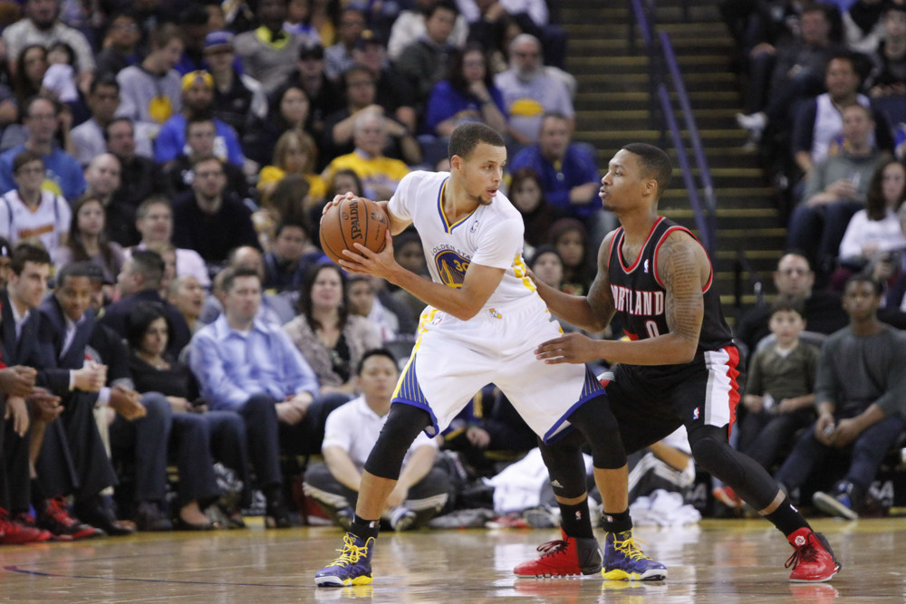 Nov. 24, 2013 - Nov 23, 2013 - Oakland, CA, USA: Damian Lillard (0) of the Portland Trail Blazers defends Stephen Curry (30) of the Golden State Warriors during a game at Oracle Arena. (Zuma Press/Icon Sportswire)