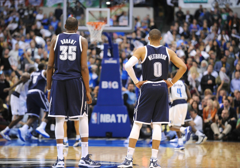 January 18, 2013: Oklahoma City Thunder small forward Kevin Durant (35) stands at mid-court alongside point guard Russell Westbrook (0) during a game against the Dallas Mavericks at the American Airlines Center in Dallas, TX. The Thunder defeated Dallas in OT 117-114. (Albert Pena/Icon Sportswire)