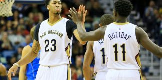 Nov 10, 2015; New Orleans, LA, USA; New Orleans Pelicans forward Anthony Davis (23) and guard Jrue Holiday (11) celebrate after a basket against the Dallas Mavericks during the first quarter of a game at the Smoothie King Center. Mandatory Credit: Derick E. Hingle-USA TODAY Sports