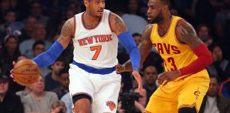 Mar 26, 2016; New York, NY, USA; New York Knicks small forward Carmelo Anthony (7) controls the ball against Cleveland Cavaliers small forward LeBron James (23) during the first quarter at Madison Square Garden. Mandatory Credit: Brad Penner-USA TODAY Sports