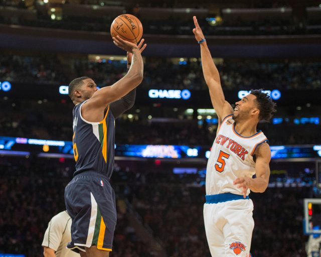 Nov 6, 2016; New York, NY, USA; Utah Jazz small forward Joe Johnson (6) shoots the ball over New York Knicks shooting guard Courtney Lee (5) during the fourth quarter at Madison Square Garden. Utah won 114-109. Mandatory Credit: Gregory J. Fisher-USA TODAY Sports