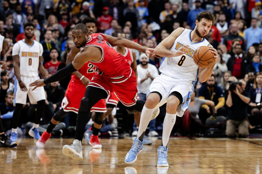 Nov 22, 2016; Denver, CO, USA; Denver Nuggets forward Danilo Gallinari (8) takes an inbound pass against Chicago Bulls guard Dwyane Wade (3) in the final seconds of the game at the Pepsi Center. The Nuggets defeated the Bulls 110-107. Mandatory Credit: Isaiah J. Downing-USA TODAY Sports