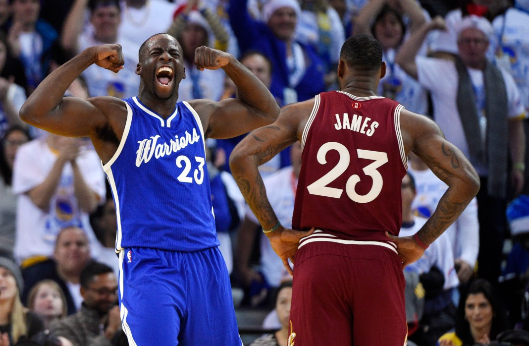 Dec 25, 2015; Oakland, CA, USA; Golden State Warriors forward Draymond Green (left) reacts as Cleveland Cavaliers forward LeBron James (right) looks on in the first half of a NBA basketball game on Christmas at Oracle Arena. Mandatory Credit: Kyle Terada-USA TODAY Sports