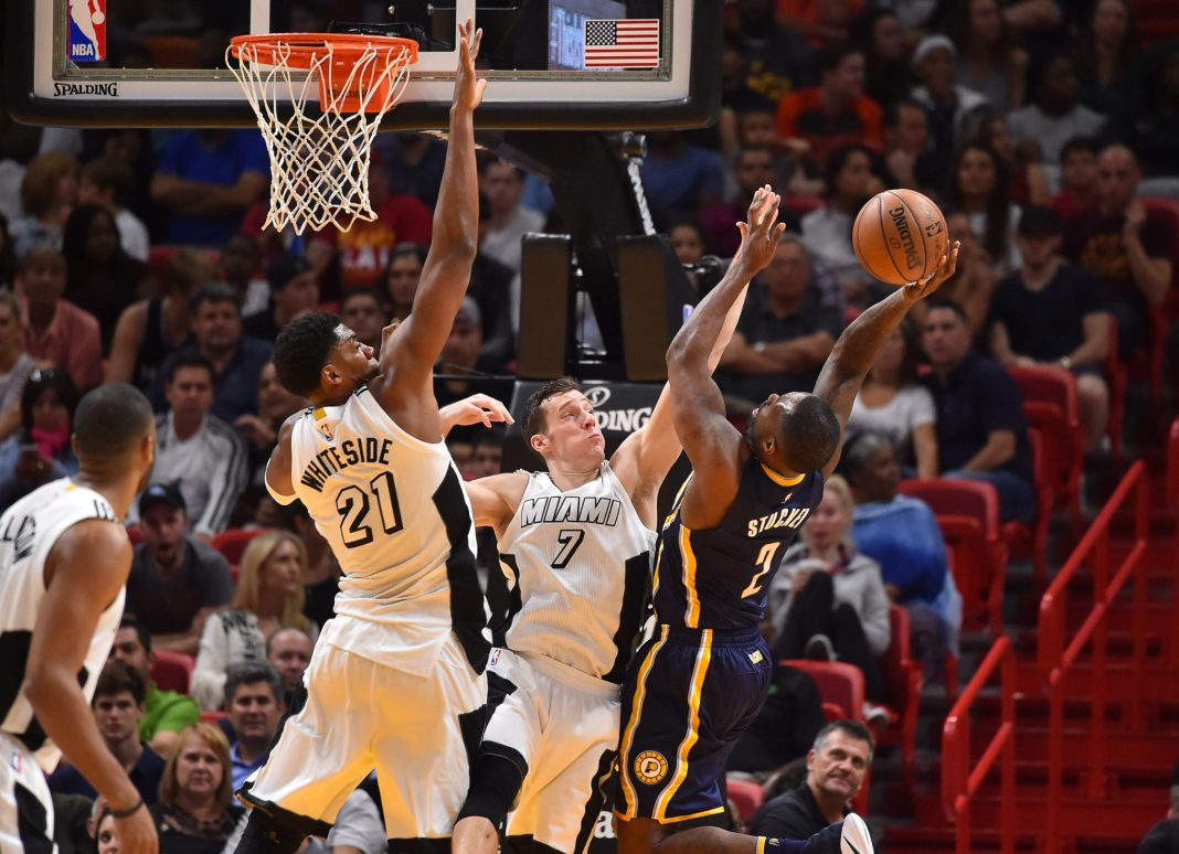 Dec 14, 2016; Miami, FL, USA; Miami Heat center Hassan Whiteside (21) and guard Goran Dragic (7) apply pressure on Indiana Pacers guard Rodney Stuckey (2) during the second half at American Airlines Arena. The Miami Heat defeat Indiana Pacers 95-89. Mandatory Credit: Jasen Vinlove-USA TODAY Sports