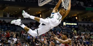 Dec 15, 2016; Milwaukee, WI, USA; Milwaukee Bucks forward Giannis Antetokounmpo (34) gets some hang time over Chicago Bulls guard Rajon Rondo (9) after dunking a basket in the third quarter at BMO Harris Bradley Center. Antetokounmpo scored 30 points to help the Bucks beat the Bulls 108-97. Mandatory Credit: Benny Sieu-USA TODAY Sports
