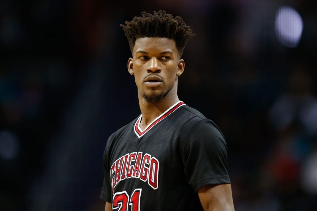 Dec 23, 2016; Charlotte, NC, USA; Chicago Bulls forward Jimmy Butler (21) stands on the court during the game against the Charlotte Hornets at Spectrum Center. The Hornets defeated the Bulls 103-91. Mandatory Credit: Jeremy Brevard-USA TODAY Sports