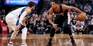Jan 1, 2017; Minneapolis, MN, USA; Portland Trail Blazers guard C.J. McCollum (3) dribbles in the first quarter against the Minnesota Timberwolves guard Ricky Rubio (9) at Target Center. Mandatory Credit: Brad Rempel-USA TODAY Sports