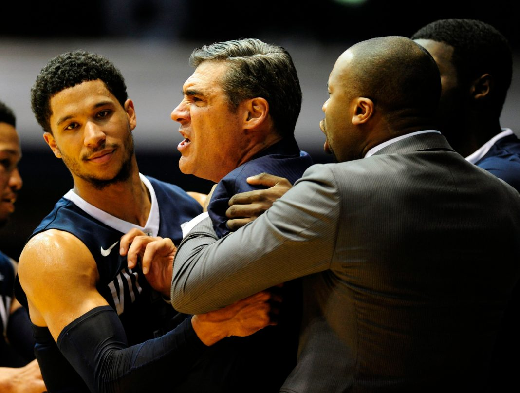 Jan 4, 2017; Indianapolis, IN, USA; Villanova head coach Jay Wright is restrained by his players and asst. coaches after receiving a Technical Foul during the first half of their game against Butler University at Hinkle Fieldhouse. Mandatory Credit: Thomas J. Russo-USA TODAY Sports