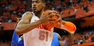 Dec 2, 2011; Syracuse, NY, USA; Syracuse Orange center Fab Melo (51) grabs a rebound during the second half of an NCAA Basketball game between the Syracuse Orange and the Florida Gators at the Carrier Dome in Syracuse, NY. Syracuse won 72-68. Mandatory Credit: Rich Barnes/Icon Sportswire