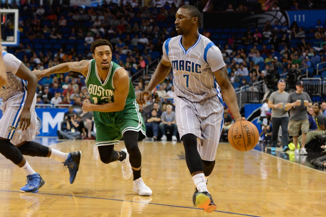 Mar 8, 2015; Orlando, FL, USA; Orlando Magic guard Ben Gordon (7) dribbles as Boston Celtics guard James Young (13) defends during the second quarter at Amway Center. Orlando Magic defeated Boston Celtics 103-98. Mandatory Credit: Tommy Gilligan-USA TODAY Sports