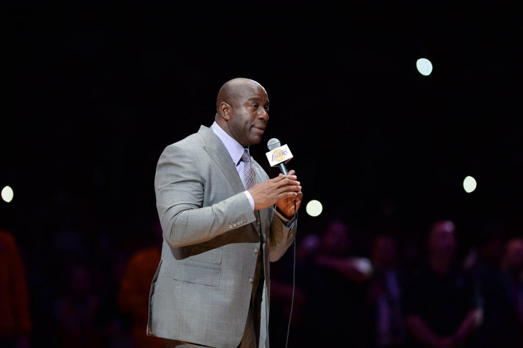 Apr 13, 2016; Los Angeles, CA, USA; Los Angeles Lakers former player Magic Johnson introduces Lakers forward Kobe Bryant (not pictured) before a game against the Utah Jazz at Staples Center. Bryant concludes his 20-year NBA career tonight. Mandatory Credit: Robert Hanashiro-USA TODAY Sports
