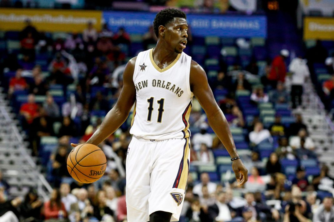 Nov 29, 2016; New Orleans, LA, USA; New Orleans Pelicans guard Jrue Holiday (11) controls the ball against the Los Angeles Lakers during the second half of a game at the Smoothie King Center. The Pelicans defeated the Lakers 105-88. Mandatory Credit: Derick E. Hingle-USA TODAY Sports