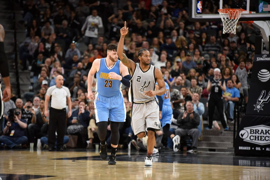 Feb 4, 2017; San Antonio, TX, USA; San Antonio Spurs forward Kawhi Leonard (2) reacts against the Denver Nuggets during the second half at the AT&T Center. The Spurs won 121-97. Mandatory Credit: Brendan Maloney-USA TODAY Sports