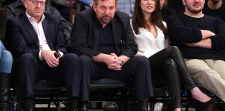 Feb 6, 2017; New York, NY, USA; Madison Square Garden chairman James Dolan (center) watches during the fourth quarter between the New York Knicks and the Los Angeles Lakers at Madison Square Garden. Mandatory Credit: Brad Penner-USA TODAY Sports
