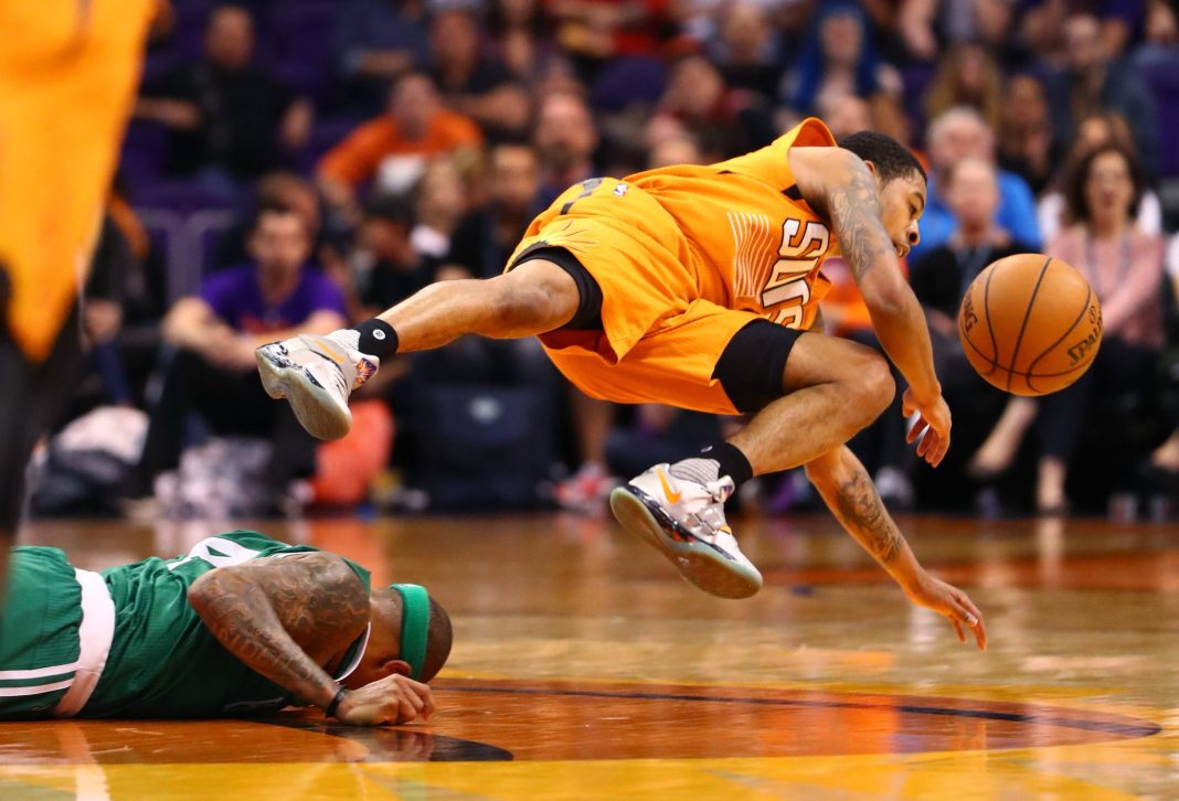 Mar 5, 2017; Phoenix, AZ, USA; Phoenix Suns guard Tyler Ulis (right) is upended after colliding with Boston Celtics guard Isaiah Thomas in the second quarter at Talking Stick Resort Arena. Mandatory Credit: Mark J. Rebilas-USA TODAY Sports