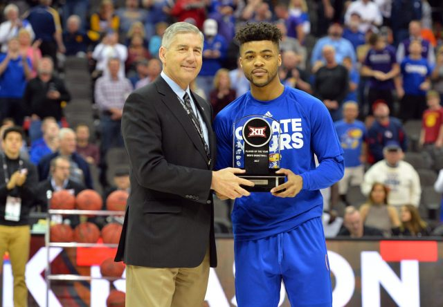 Mar 9, 2017; Kansas City, MO, USA; Big12 commissioner Bob Bowlsby presents Kansas Jayhawks guard Frank Mason III (0) the trophy for player of the year before the game against the TCU Horned Frogs during the Big 12 Championship Tournament at Sprint Center. Mandatory Credit: Denny Medley-USA TODAY Sports