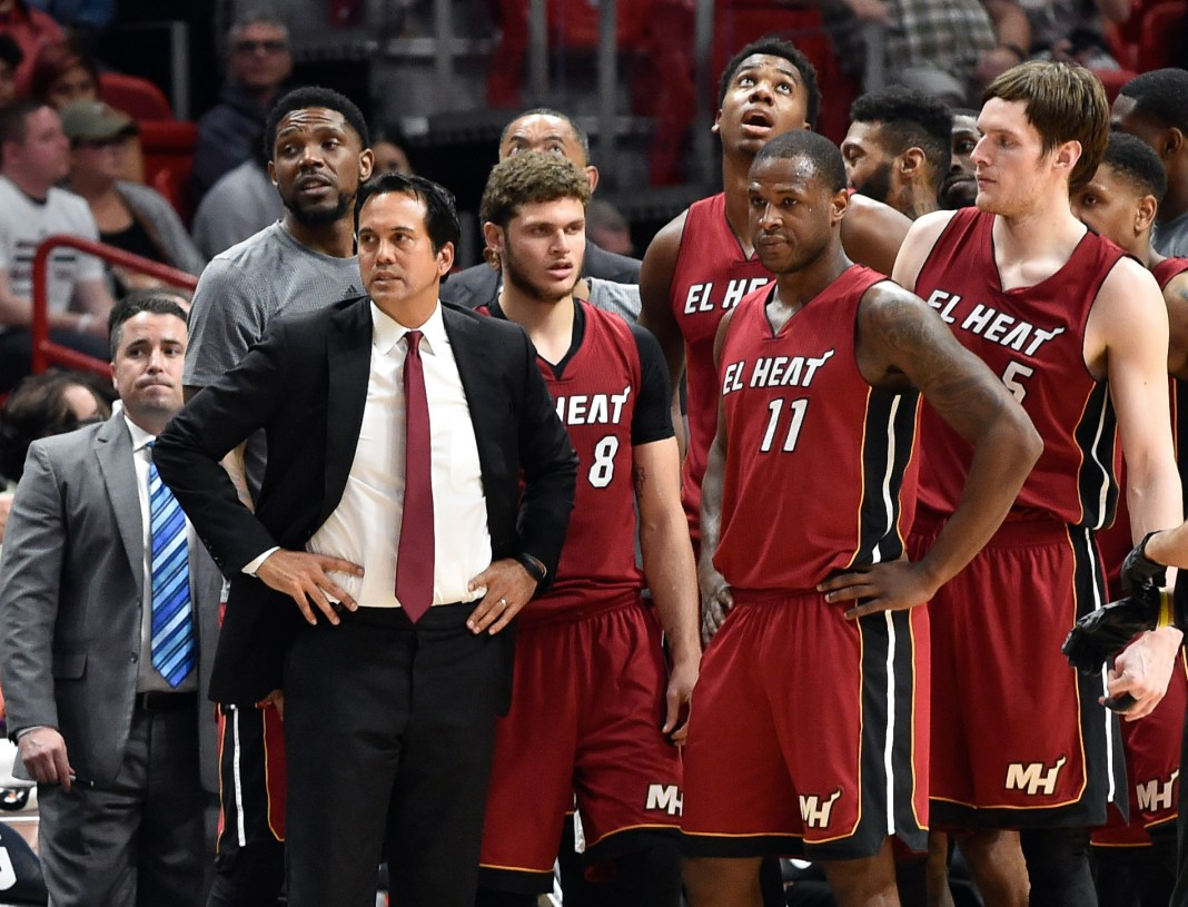 Mar 11, 2017; Miami, FL, USA; Miami Heat head coach Erik Spoelstra stands in front of his players during a timeout in the second half against the Toronto Raptors at American Airlines Arena. The Heat won 104-89. Mandatory Credit: Steve Mitchell-USA TODAY Sports