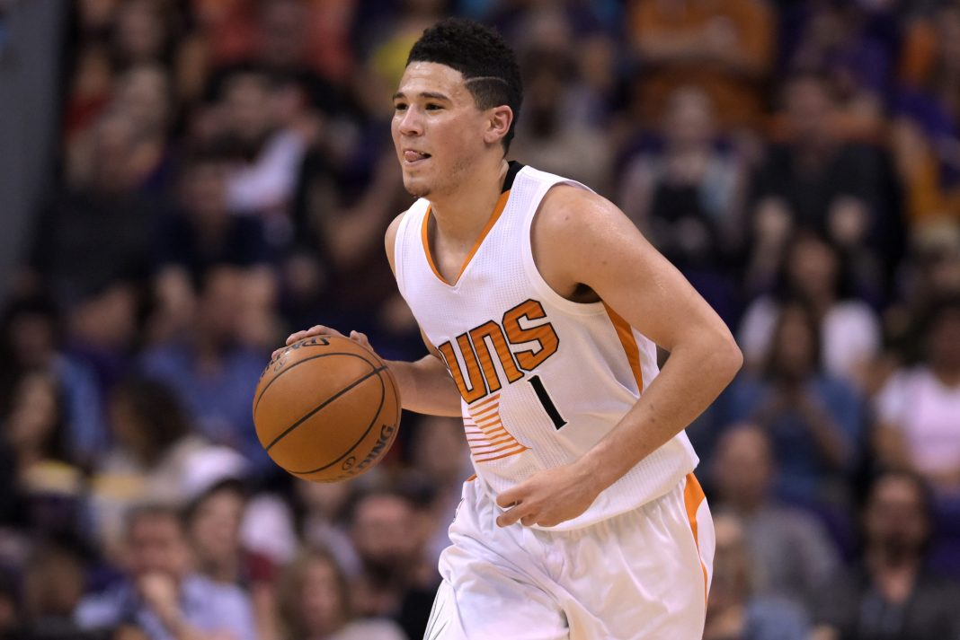 Mar 15, 2017; Phoenix, AZ, USA; Phoenix Suns guard Devin Booker (1) dribbles the ball up the court against the Sacramento Kings in the first half at Talking Stick Resort Arena. Mandatory Credit: Jennifer Stewart-USA TODAY Sports
