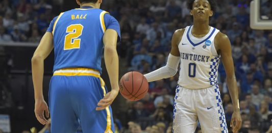 Mar 24, 2017; Memphis, TN, USA; Kentucky Wildcats guard De'Aaron Fox (0) looks to pass the ball against UCLA Bruins guard Lonzo Ball (2) in the second half during the semifinals of the South Regional of the 2017 NCAA Tournament at FedExForum. Mandatory Credit: Justin Ford-USA TODAY Sports