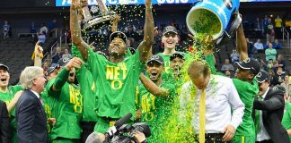 Mar 25, 2017; Kansas City, MO, USA; Oregon Ducks head coach Dana Altman is doused by confetti by his players as they celebrate with the trophy after the game against the Kansas Jayhawks in the finals of the Midwest Regional of the 2017 NCAA Tournament at Sprint Center. Oregon defeated Kansas 74-60. Mandatory Credit: Denny Medley-USA TODAY Sports