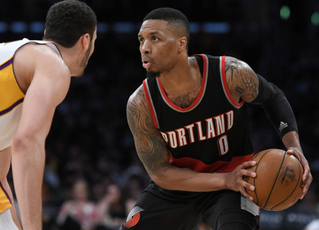 Mar 26, 2017; Los Angeles, CA, USA; Portland Trail Blazers guard Damian Lillard (0) looks to the basket as he is guarded by Los Angeles Lakers forward Larry Nance Jr. (7) during the second half at Staples Center. Mandatory Credit: Robert Hanashiro-USA TODAY Sports