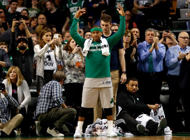 Apr 12, 2017; Boston, MA, USA; Boston Celtics guard Isaiah Thomas (4) celebrates in the final moments of the Boston Celtics 112-94 win over the Milwaukee Bucks at TD Garden. Mandatory Credit: Winslow Townson-USA TODAY Sports