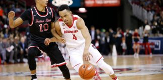 Feb 18, 2017; Fresno, CA, USA; New Mexico Lobos guard Elijah Brown (4) dribbles past Fresno State Bulldogs guard Johnny McWililams (10) in the first half at the Save Mart Center. Mandatory Credit: Cary Edmondson-USA TODAY Sports