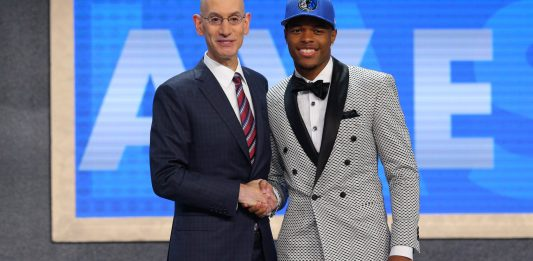 Jun 22, 2017; Brooklyn, NY, USA; Dennis Smith, Jr. (NC State) is introduced by NBA commissioner Adam Silver as the number nine overall pick to the Dallas Mavericks in the first round of the 2017 NBA Draft at Barclays Center. Mandatory Credit: Brad Penner-USA TODAY Sports