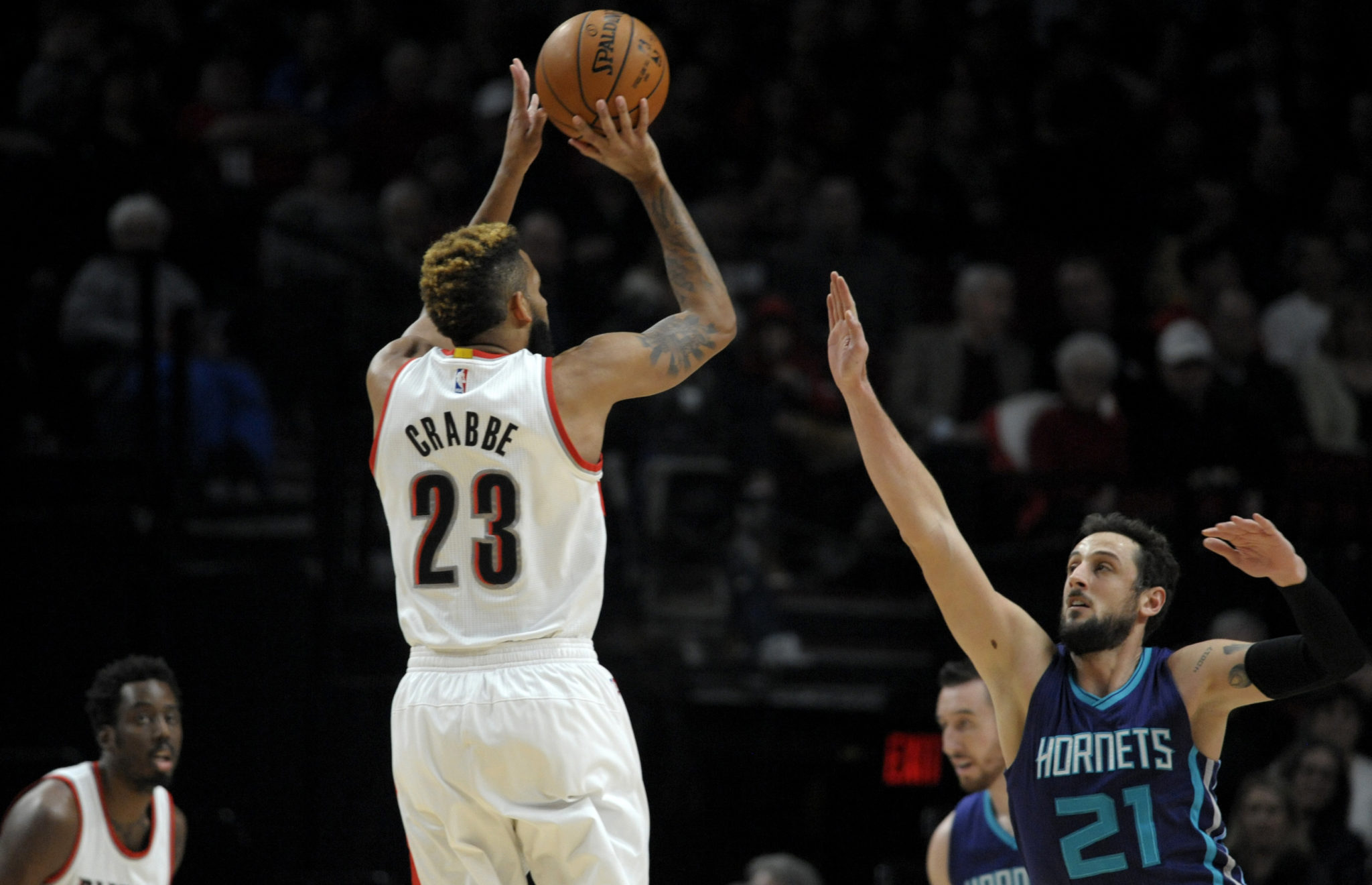 Jan 31 2017 Portland OR USA Portland Trail Blazers guard Allen Crabbe shoots the ball over Charlotte Hornets guard Marco Belinelli during the first quarter at the Moda Center. Mandatory Credit Steve Dykes-USA TODAY Sports