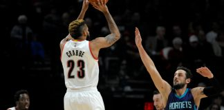 Jan 31, 2017; Portland, OR, USA; Portland Trail Blazers guard Allen Crabbe (23) shoots the ball over Charlotte Hornets guard Marco Belinelli (21) during the first quarter at the Moda Center. Mandatory Credit: Steve Dykes-USA TODAY Sports