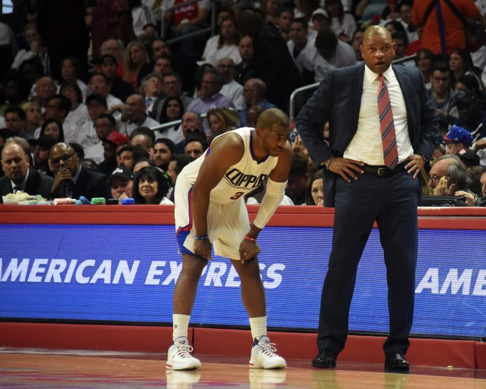 April 25, 2017; Los Angeles, CA, USA; Los Angeles Clippers guard Chris Paul (3) speaks with head coach Doc Rivers in a stoppage in play against the Utah Jazz during the first half in game five of the first round of the 2017 NBA Playoffs at Staples Center. Mandatory Credit: Richard Mackson-USA TODAY Sports