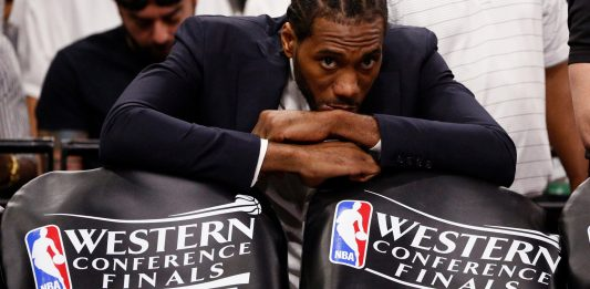 May 20, 2017; San Antonio, TX, USA; San Antonio Spurs small forward Kawhi Leonard (in suit) watches from the bench against the Golden State Warriors during the first half in game three of the Western conference finals of the NBA Playoffs at AT&T Center. Mandatory Credit: Soobum Im-USA TODAY Sports