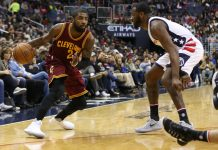 Nov 11, 2016; Washington, DC, USA; Cleveland Cavaliers guard Kyrie Irving (2) dribbles the ball as Washington Wizards guard John Wall (2) defends in the second quarter at Verizon Center. Mandatory Credit: Geoff Burke-USA TODAY Sports