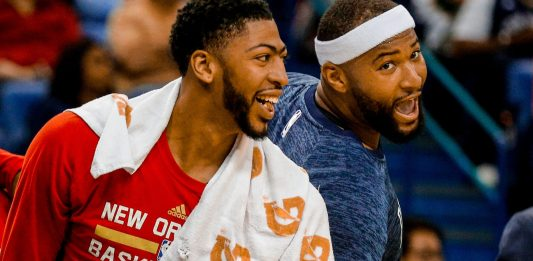 Mar 31, 2017; New Orleans, LA, USA; New Orleans Pelicans forward Anthony Davis (23) celebrates from the bench with forward DeMarcus Cousins (0) during the fourth quarter of a game against the Sacramento Kings at the Smoothie King Center. The Pelicans defeated the Kings 117-89. Mandatory Credit: Derick E. Hingle-USA TODAY Sports