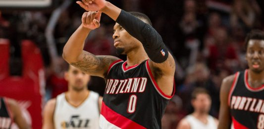 Apr 8, 2017; Portland, OR, USA; Portland Trail Blazers guard Damian Lillard (0) celebrates after scoring a basket during the second half in a game against the Utah Jazz at Moda Center. The Trail Blazers won 101-86. Mandatory Credit: Troy Wayrynen-USA TODAY Sports