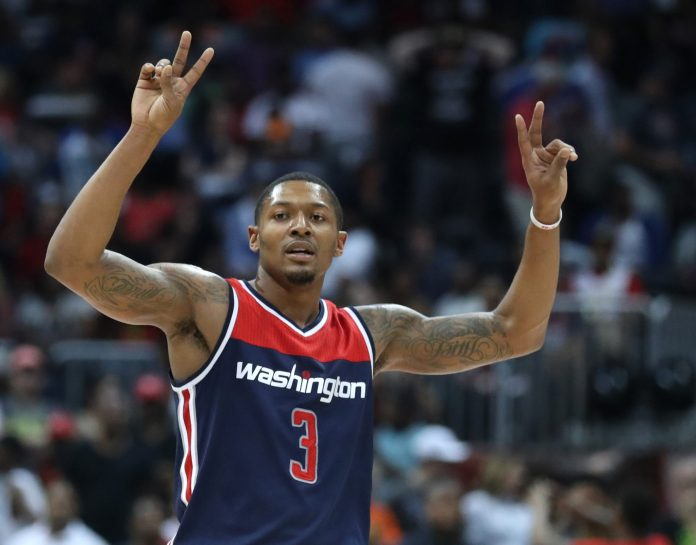 Apr 28, 2017; Atlanta, GA, USA; Washington Wizards guard Bradley Beal (3) celebrates in the closing minutes of their game against the Atlanta Hawks in game six of the first round of the 2017 NBA Playoffs at Philips Arena. Mandatory Credit: Jason Getz-USA TODAY Sports