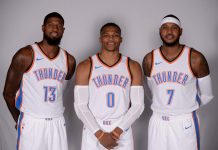 Sep 25, 2017; Oklahoma City, OK, USA; Oklahoma City Thunder forward Paul George (13), guard Russell Westbrook (0) and forward Carmelo Anthony (7) pose for photos during the Oklahoma City Thunder Media Day at Chesapeake Energy Arena. Mandatory Credit: Mark D. Smith-USA TODAY Sports