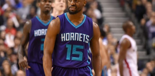 Mar 29, 2017; Toronto, Ontario, CAN; Charlotte Hornets guard Kemba Walker (15) reacts after sinking a basket against Toronto Raptors at Air Canada Centre. The Hornets won 110-106. Mandatory Credit: Dan Hamilton-USA TODAY Sports